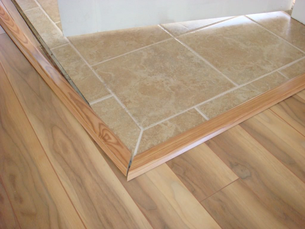 Используем гибкий порог для ламината и плитки